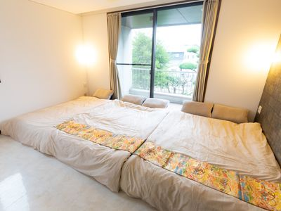 Photo for Private room with shower / toilet 1-5 people (2 double beds 1 single bed)