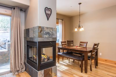 Dining Area - Enjoy a gas fireplace by the dining area in the open living space.