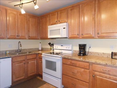 Photo for S6 Ocean Walk Resort  is a three bedroom two bath upstairs unit that has new hardwood floors and kitchen was updated in 2016.  Kitchen is well stocked, bedding is a king ,queen and two twins. Covered deck, close to tennis courts and pool.