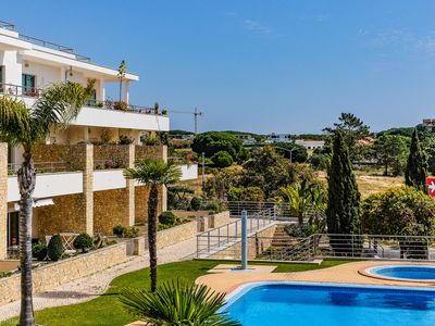 Photo for Nice penthouse 500m from the beach with wifi, pool and A/C