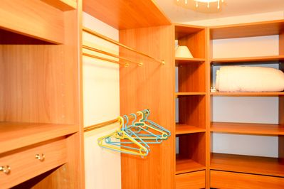 Walk-in closet to master bedroom