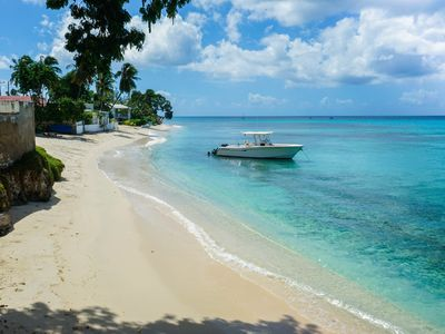 Photo for Beautiful 2-Bedroom Apartment right on the beach in this tranquil little bay