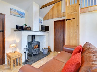 Photo for A footpath from the door of this pretty cottage for 2 leads to the 300 acres of forestry, the waterf