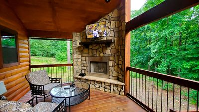 Outdoor Fireplace with TV and Seating Area