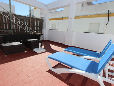 Photo for Stylishly furnished, cozy townhouse near the beach and centrally located