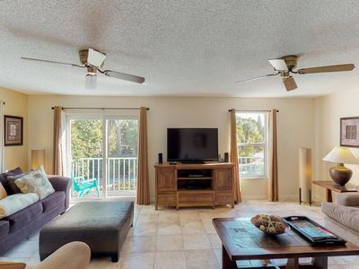 Photo for Island-style townhome with shared pool only moments from the beach!