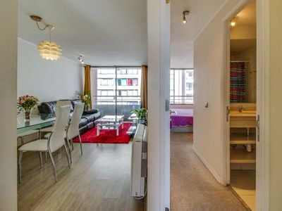 Photo for Explore the heart of Santiago with this condo featuring a shared pool!