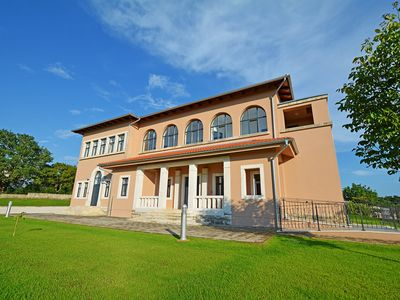 Photo for This 9-bedroom villa for up to 22 guests is located in Porec and has a private swimming pool, air-co
