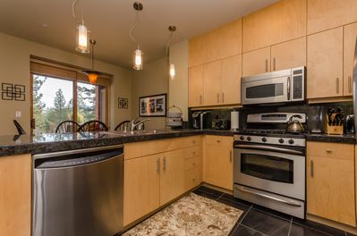 Fully equipped kitchen features high end stainless steel appliances.