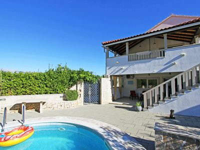 Photo for This 7-bedroom villa for up to 14 guests is located in Selca and has a private swimming pool, air-co