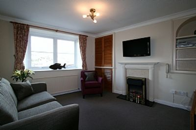 Photo for Ground Floor Holiday Apartment In Brixham Overlooking The Harbour