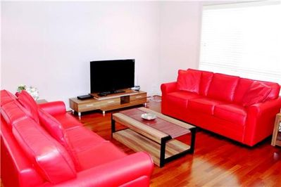Spacious living area with two double sofas