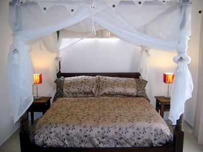 Luxurious teak canopy beds