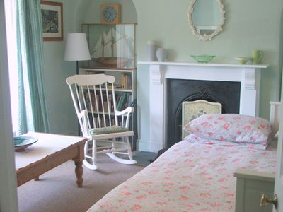 blue sitting room with day bed made up