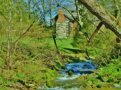 Photo for Creekside historic log cabin with all modern amenities at historic Wade's Mill