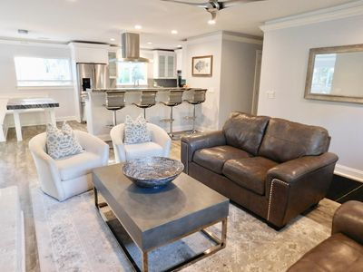 The living room, kitchen, and sunroom are all open concept so you can move free.
