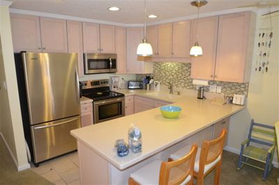 Well amenitized kitchen with stainless steel appliances