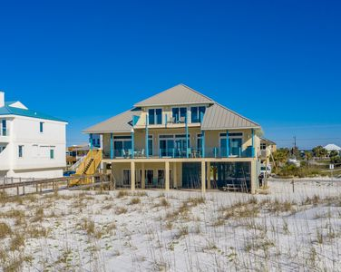 Photo for Gulf Front. Spacious Living Area. Private boardwalk for easy beach access.
