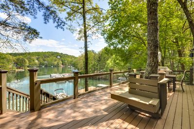 Built in seating on large deck.  Glass balusters and resin deck.