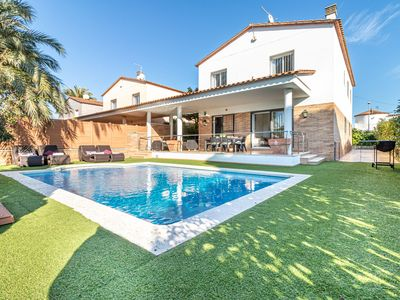 Photo for Stylish, spacious villa with private swimming pool walking distance of the beach