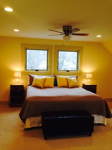 King size bed with fan above.
