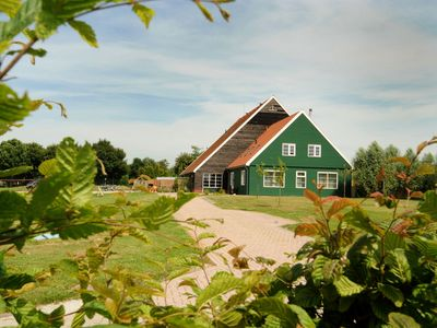 Photo for Charming villa with enclosed garden right on the dike on a holiday park on the IJsselmeer