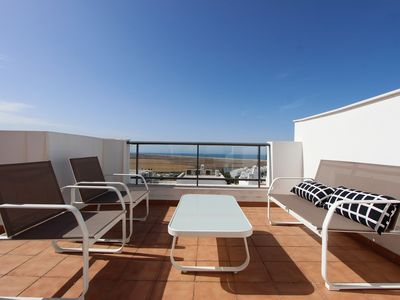 Photo for Modern terraced house with roof terrace, sea views and communal pool