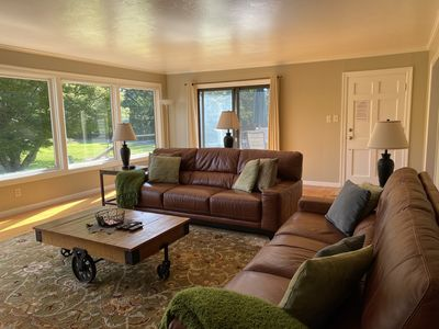 Large spacious great room with 2 full size sofas and expansive views of Hood Mtn