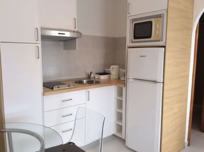 Open, fully fitted kitchen including microwave