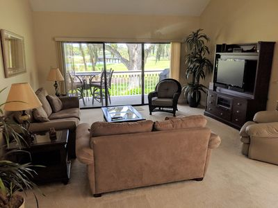 Living room with great views of lagoon and golf course
