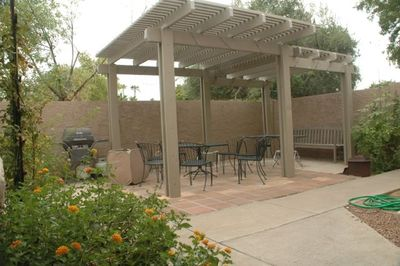 Large courtyard on the property with BBQ for entertaining friends and family.