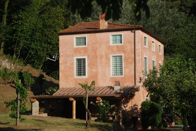 Main house and covered terrace with pizza oven