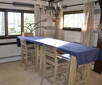 8' dining table with beautiful views of the lake from all sides!