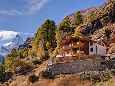 Photo for This 5-bedroom villa for up to 10 guests is located in Zermatt and has a private swimming pool and W
