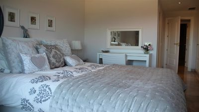 Beautifully furnished main bedroom.Bedside lights have usb charging facility!