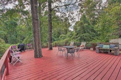 You'll love the natural beauty of the spacious deck, overlooking the woods.