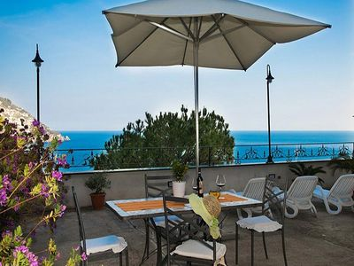 Photo for Villa Ursula B: A charming apartment that covers the entire top floor of a villa located in the center of Positano, with Free WI-FI.