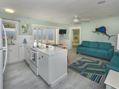 Photo for Beautiful 2 Bedroom Oceanfront Bungalow with Pool & Dockage - 75691 Overseas Hwy.