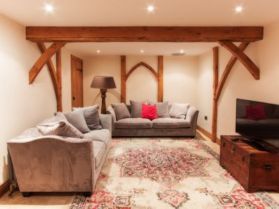 Photo for Beautifully restored cosy barn in welsh coastal town, Porthcawl. Sleeps 10.