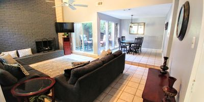 View from the front door of this open concept living and dining area