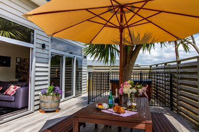 Welcome to Ti Kouka House, outdoor living & dining on a large sunny private deck