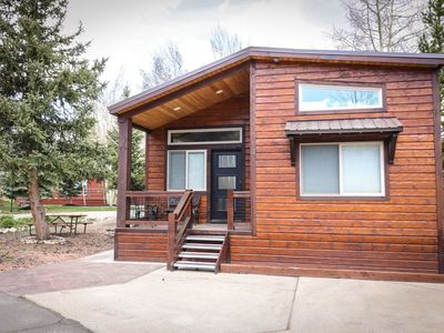 Photo for NEW! 2 Bedroom moderns style cabin with huge living space, gorgeous fully furnished kitchen, lovely family dining area, top of the line decor, and back patio with a beautiful view of the aspen trees