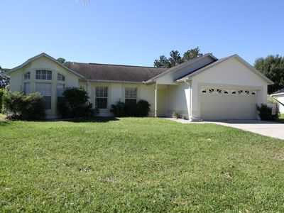 Photo for 4 bed pool home in quiet location near Champions Gate