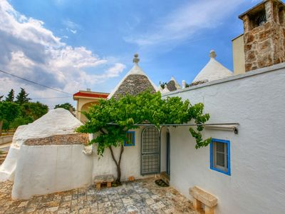 Photo for Typical trullo with conical roof in excellent area close to the sea
