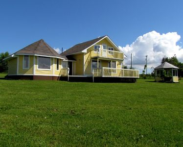 View of the summer home from the large green yard