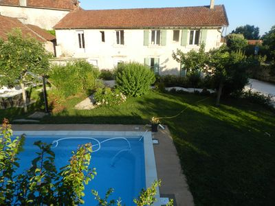 Photo for Apartments in large stone house with pool in the Dordogne