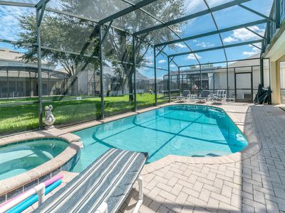 Photo for NEW LISTING! Immaculate family home w/ private, heated pool - minutes to Disney