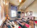 Living Area - Enjoy the warm ambiance of the cozy fireplace in the living area.