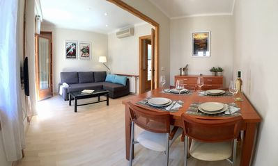 Dining table set for 4 and corner sofa in lounge