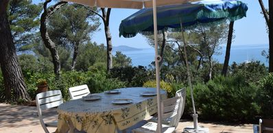 Photo for Coquette house with garden under the pines and sea view in Gaou Benat
